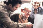 Man helping Elderly on Notebook
